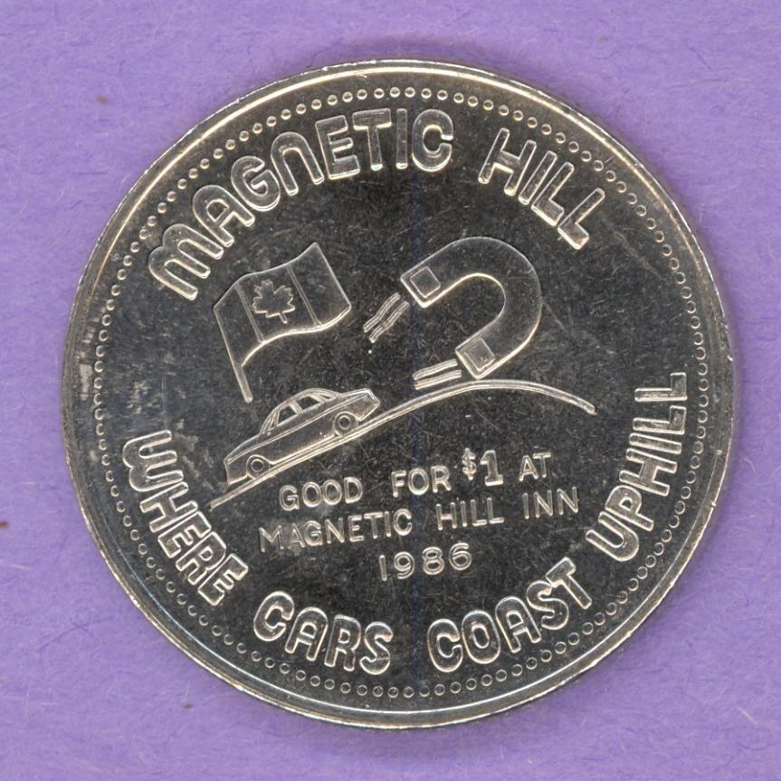 1986 Magnetic Hill New Brunswick Trade Token Magnet Pulling Car Uphill